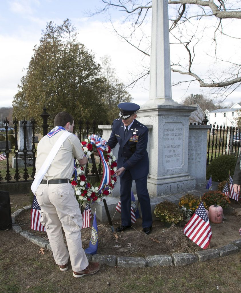 Major General William N. Reddel III, adjutant general of Army and Air Nation Guard of  New Hampshire, and Eagle Scout Matthew Steinhauser of Concord's Troop 88 place a wreath on the grave of President Franklin Pierce at Old North cemetery Tuesday. GEOFF FORESTER