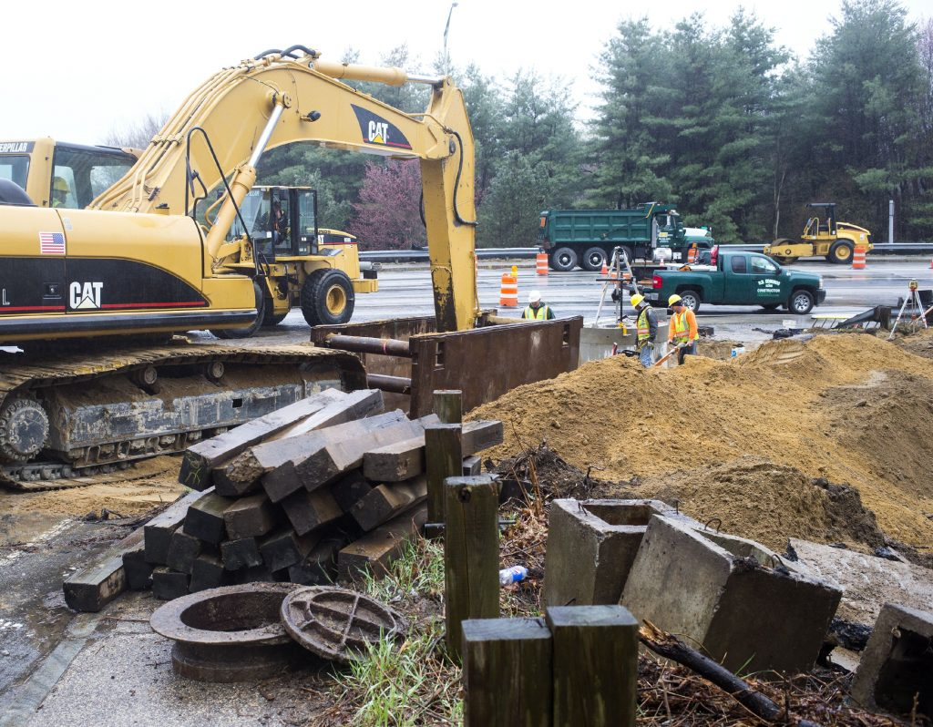 Construction workers from R.D. Edmunds of Franklin attend to the drainage lines as the site work has begun for the roundabout on Mountain Road in East Concord near exit 16 of I-93 Friday. GEOFF FORESTER