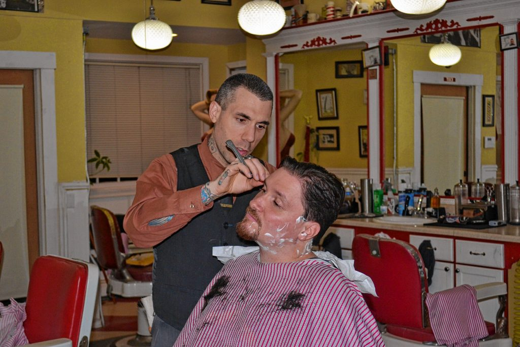 Tim got rid of what equated to an adult-inspired bowl cut and has a brand-new look thanks to Lucky's Barbershop's owner Josh Craggy. Courtesy