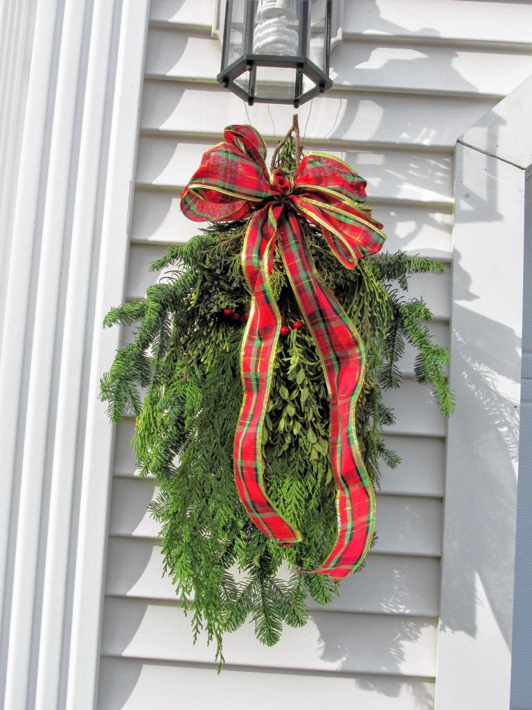 Swags can make a great outdoor decoration for the holiday – and they're inexpensive and easy to make. Courtesy of Joyce Kimball