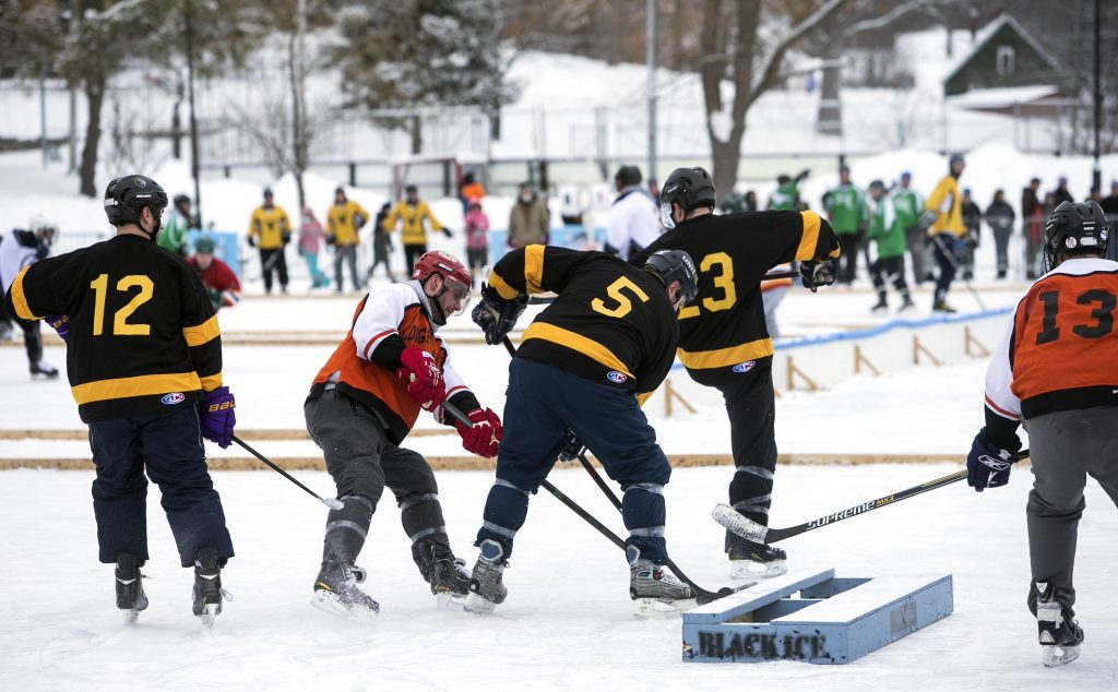 Hockey players at the Black Ice tournament at White Park Saturday. GEOFF FORESTER