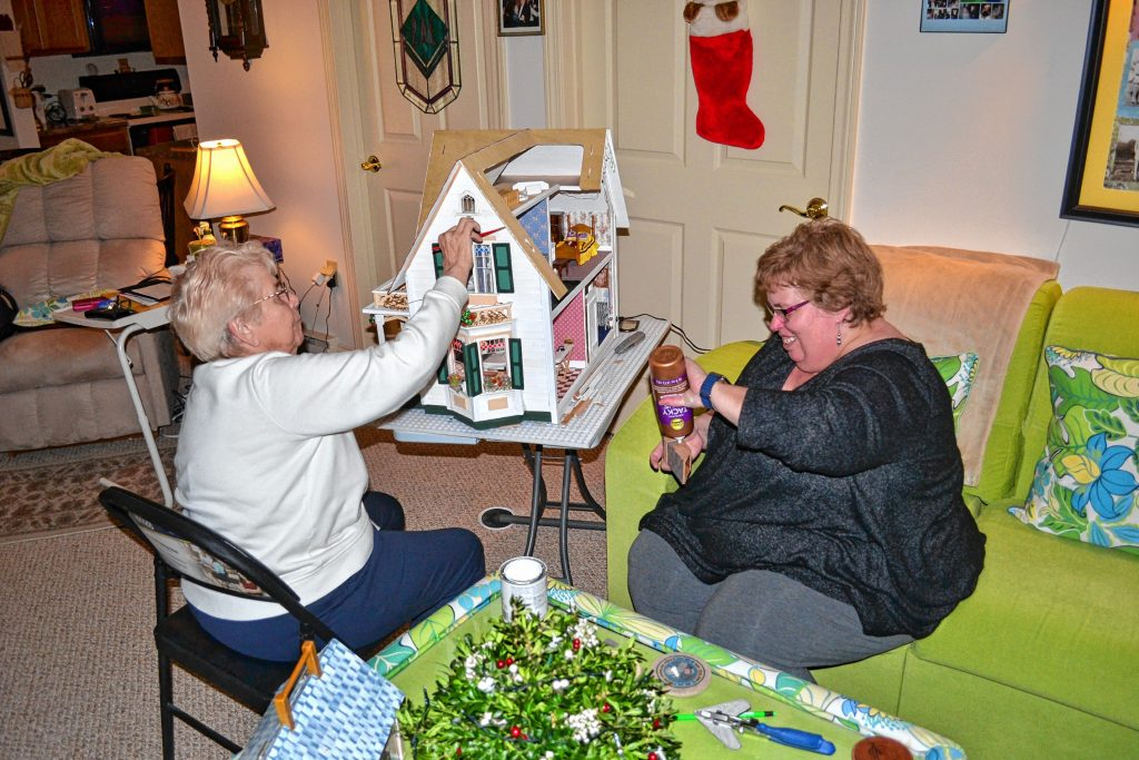 Mother and daughter, Rae Edmunds and Lonna Abbott, have been building dollhouses together for many years and are currently working on a replica of Edmunds's childhood home on Mountain Road. TIM GOODWIN / Insider staff