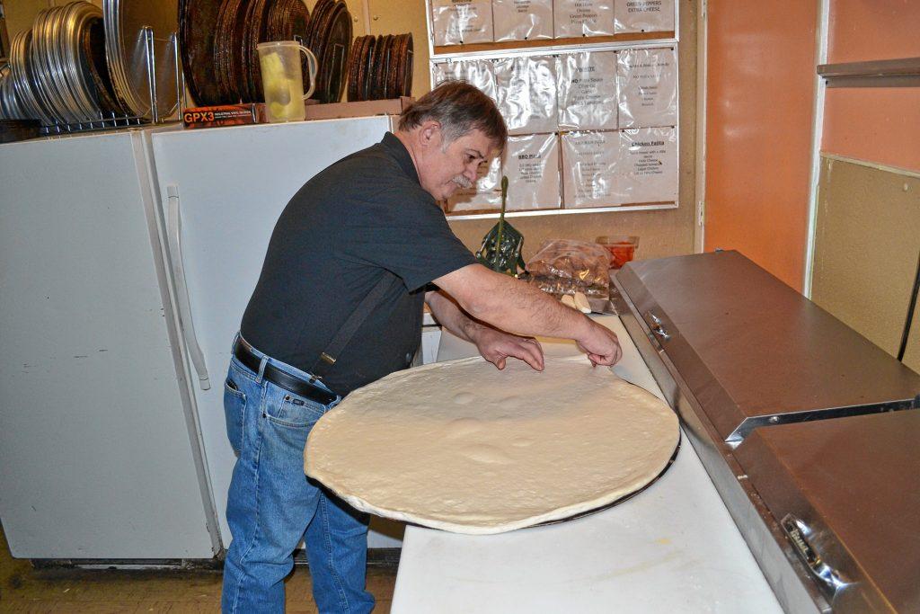 Donatello's owner Bob Boisvert gets the dough just right for the 28-inch super dominator. TIM GOODWIN / Insider staff