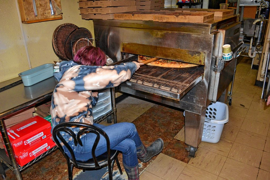 Rylee Orlosk got the envious job of sitting at the end of the oven and popping bubbles in one of Donatello's famous super dominators. TIM GOODWIN / Insider staff