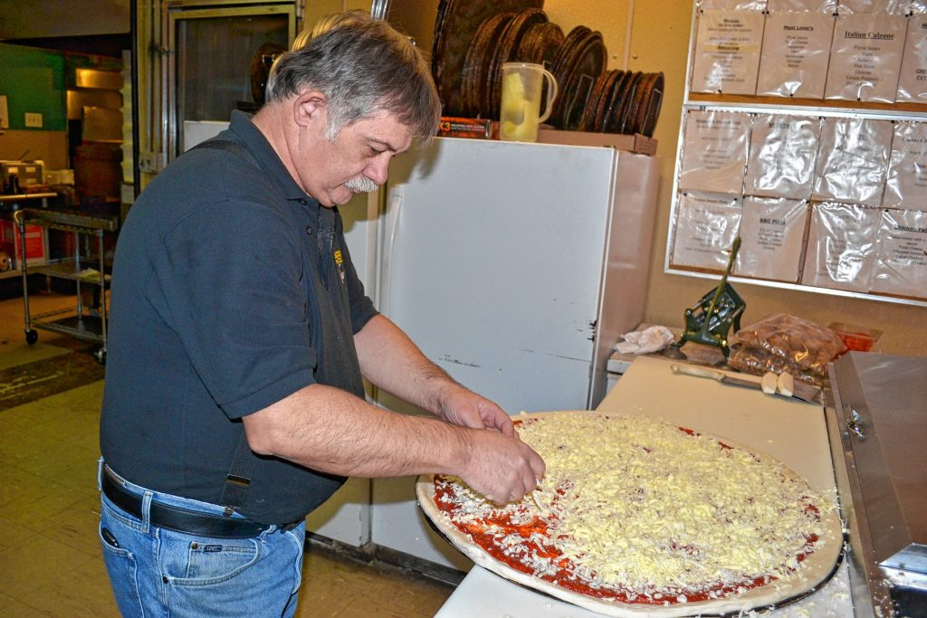 A Donatello's super dominator gets three pounds of cheese. TIM GOODWIN / Insider staff