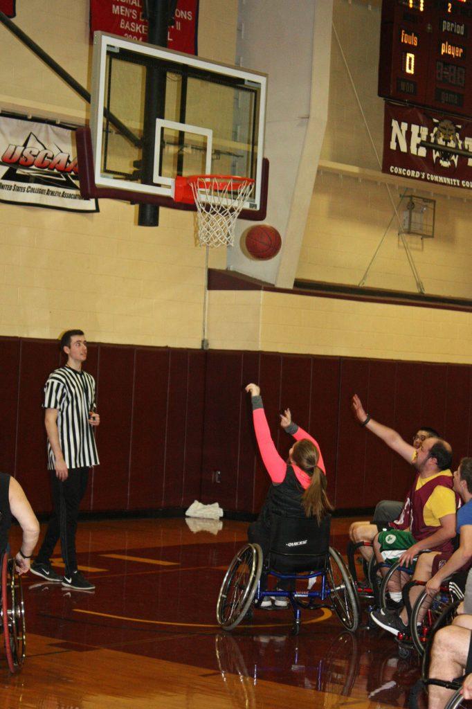 NHTI student Terri Folsom puts up a close-range shot during the Wheelchair Basketball Benefit last week. (JON BODELL / Insider staff) JON BODELL / Insider staff
