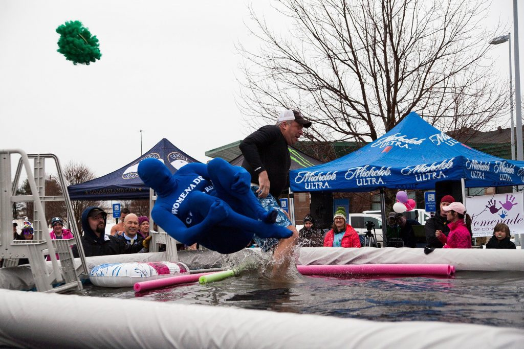 Bill Fitzgerald (left) canonballs into the pool during the Womanade Polar Plunge event. Fitzgerald won best dressed plunger on Sunday, March 15, 2015.  (CAMERON JOHNSON / Monitor staff) CAMERON JOHNSON