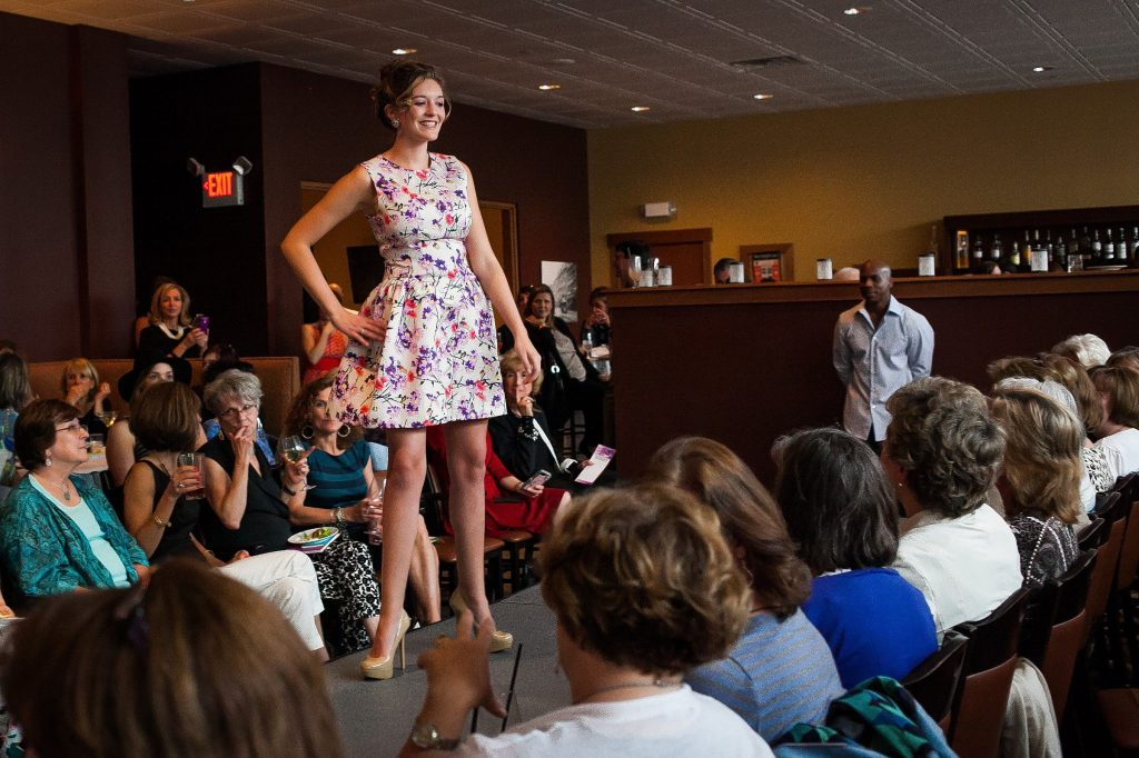Ally Deeran wears a look from Lilise during Couture for a Cause, a fashion show and silent auction to benefit Womenade of Concord, at O Steaks & Seafood's Capital Club in Concord on Thursday, May 14, 2015.  (ELIZABETH FRANTZ / Monitor staff) ELIZABETH FRANTZ