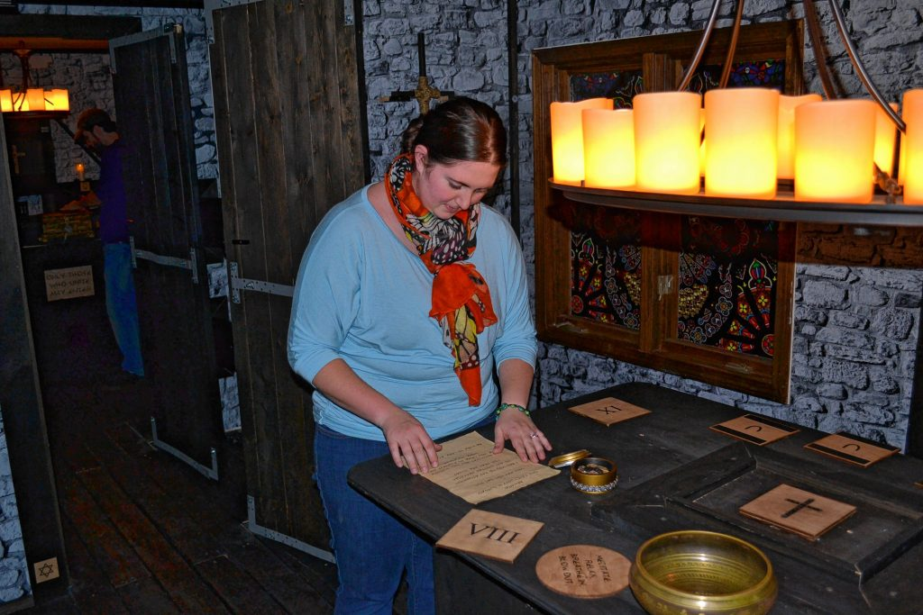 Monitor staffer Sarah Pearson is hard at work trying to crack the case of The Sanctuary at Escape Room Concord. TIM GOODWIN / Insider staff