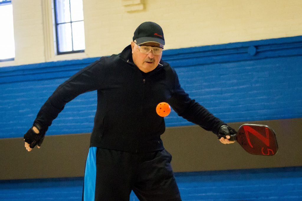 Steve Michlovitz keeps his eyes on the ball during a game of pickleball at the Green Street Community Center in Concord on Friday, Jan. 26, 2018. (ELIZABETH FRANTZ / Monitor staff) Elizabeth Frantz