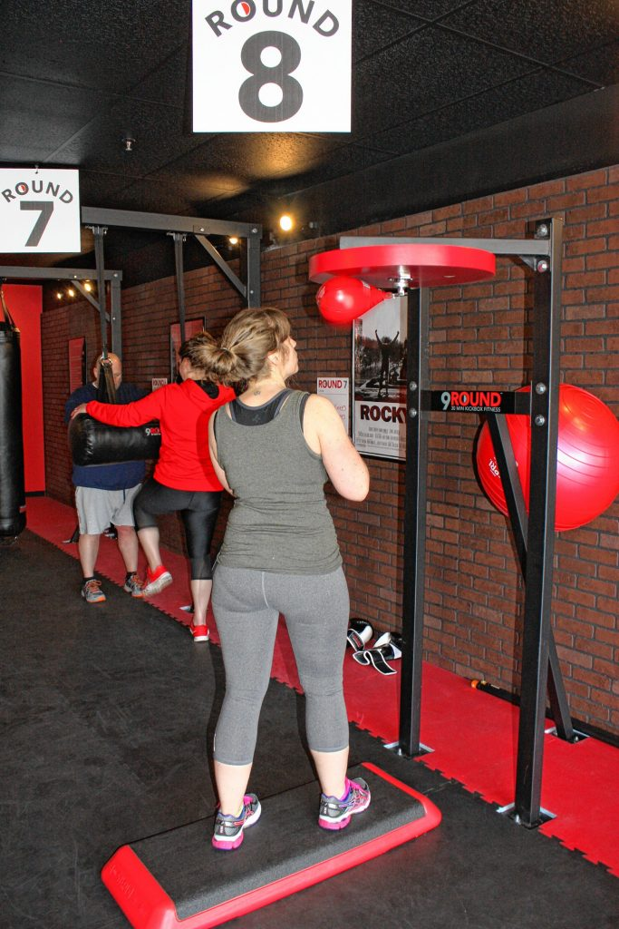 Angi Ford gets some work in on the speed bag at 9Round, the 30-minute kickboxing gym on Fort Eddy Road. Ford has been going to 9Round for about a month, she said. JON BODELL / Insider staff