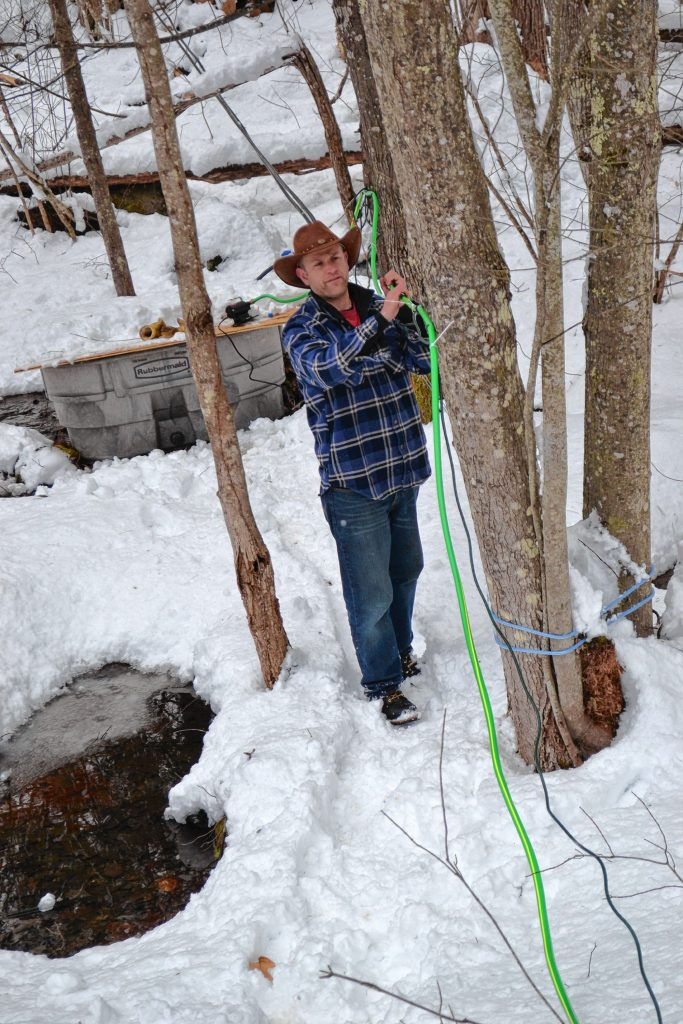 Andrew Mattiace works to find the frozen spot in his sap transfer hose. TIM GOODWIN / Insider staff
