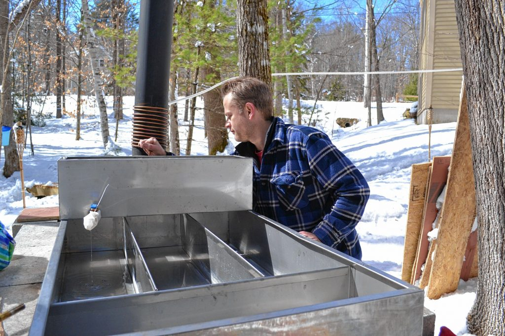 Andrew Mattiace makes sure the sap is flowing into his evaporator for last weekend's boil. TIM GOODWIN / Insider staff