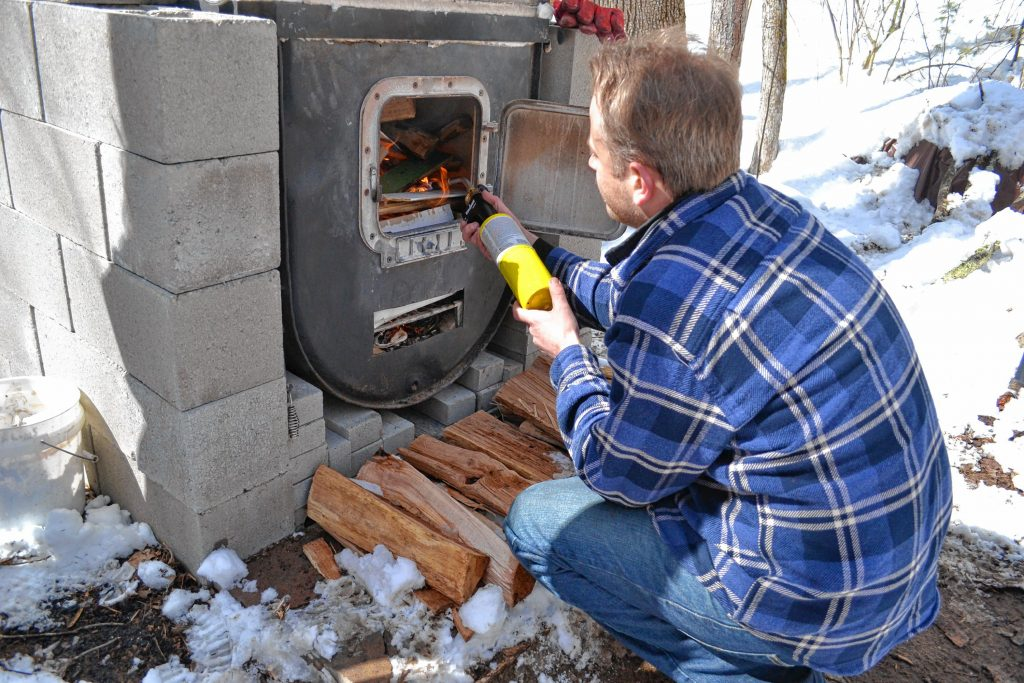 Andrew Mattiace doesn't mess around when getting his outdoor evaporator fired up. TIM GOODWIN / Insider staff