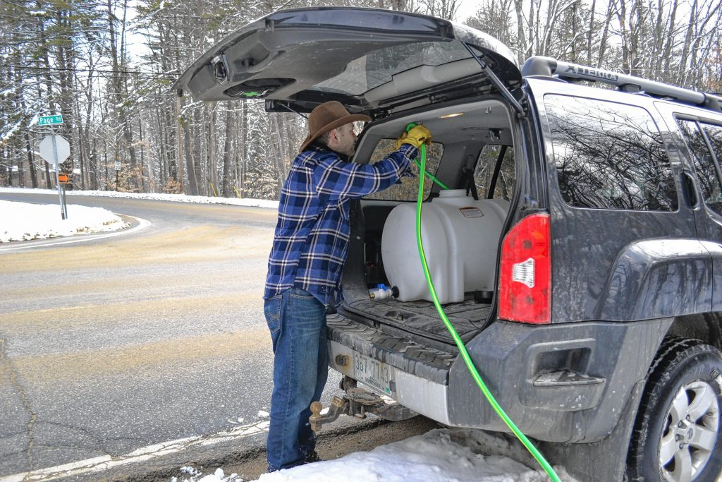 Andrew Mattiace gets his sap to flow from his roadside storage container to the holding tank in the back of his vehicle. TIM GOODWIN / Insider staff