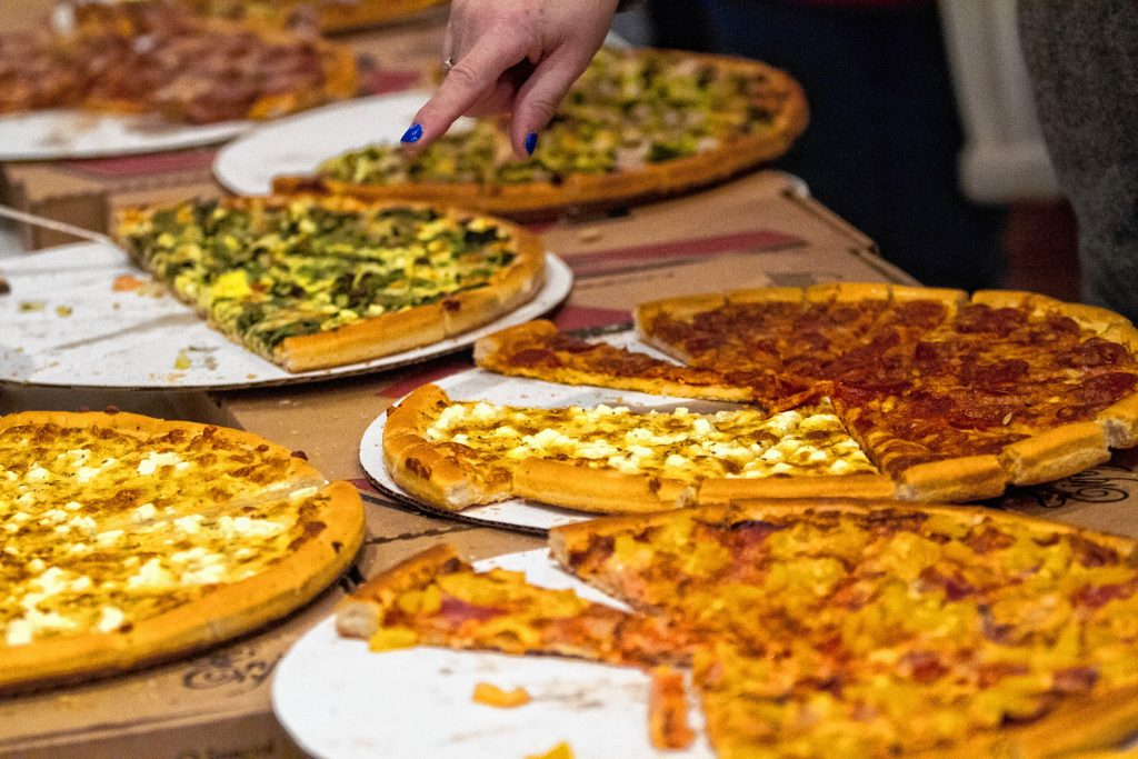 Chiefs Place serves slices during the Pizza Pie Showdown at the Holiday Inn in downtown Concord on Pi Day, Mar. 14, 2018. Proceeds from the event, hosted by the Concord Monitor and Insider, went to support the Friendly Kitchen. (ELIZABETH FRANTZ / Monitor staff) Elizabeth Frantz