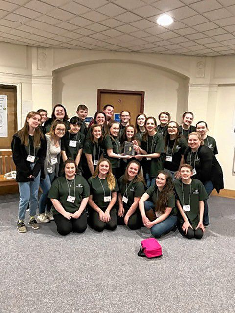 The Bow High School drama club shows off its New Hampshire Educational Theatre Guild's regional plaque after finishing in the top two on Saturday and advancing to the state festival. Courtesy