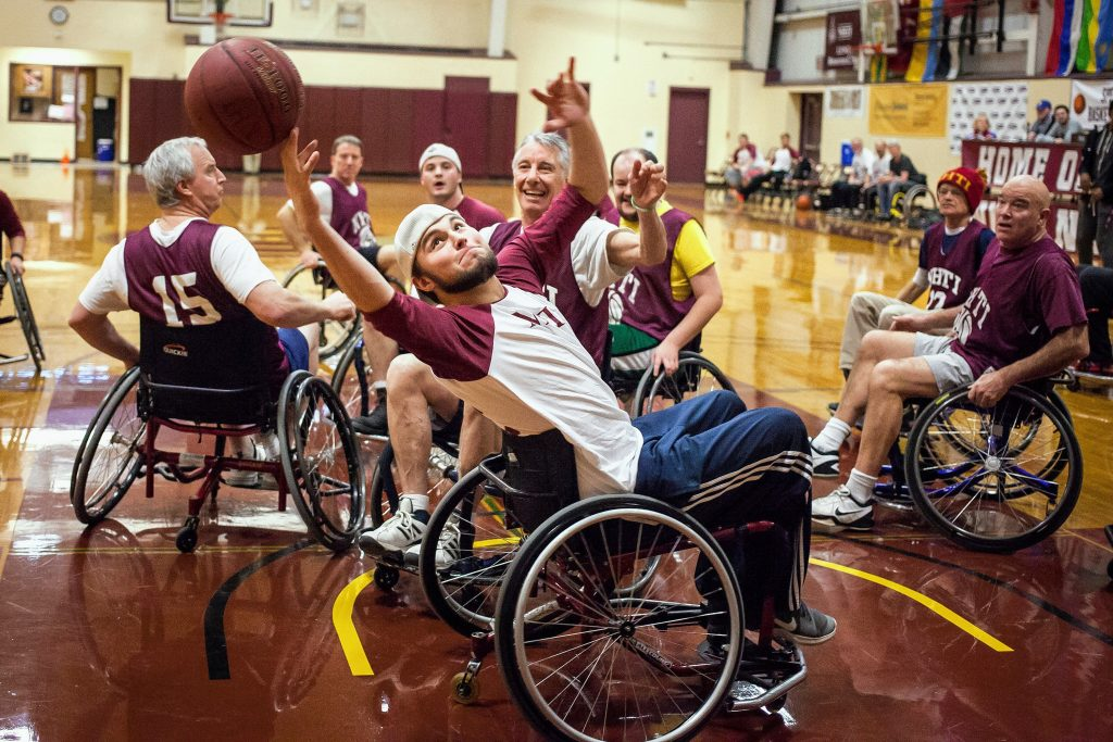 NHTI freshman Logan Elliott stretches for a rebound during the wheelchair basketball benefit for the Zech DeVits Memorial Equipment Fund at NHTI in Concord on Thursday, Feb. 2, 2017. (ELIZABETH FRANTZ / Monitor staff) Elizabeth Frantz