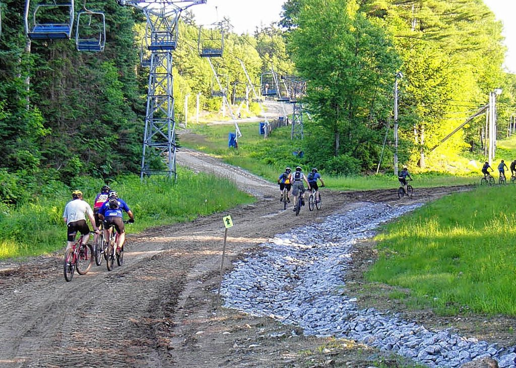 Competitors launch on the 24/12/6 hours of Pats Peak bike ride. The combination of mud and sunshine makes it more fun. This year's Pats Peak Mountain Bikle Festival is June 14 and 15. (Tim Jones/EasternSlopes.com photo) Competitors take off for the 24/12/6 Hours of Pats Peak bike ride at the mountain in Henniker. Riders can compete solo or in teams of two, four or five. The event is June 14-15.