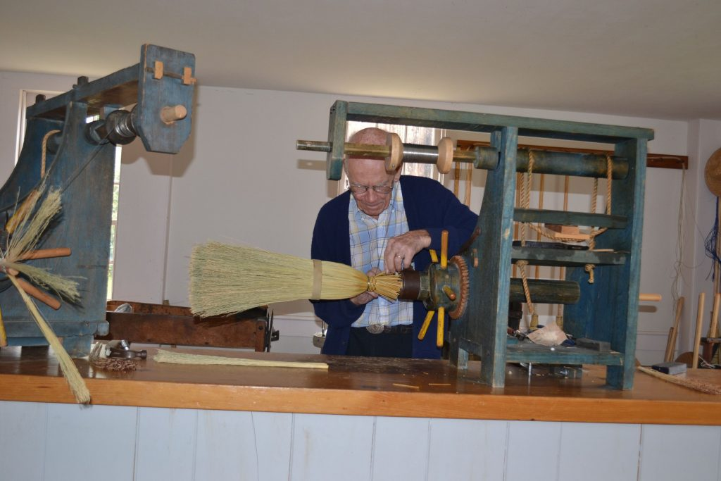 Joe Rogers does his broom making demonstration during a tour of Canterbury Shaker Village. Tim Goodwin / Insider staff