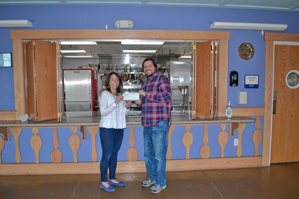 Tim dropped off a check to Friendly Kitchen director Tricia Foisey last week in the amount of $858.14 – proceeds from the Pizza Pie Showdown. You might need a magnifying glass to see, but that's what the normal sized check says. TERRY BLAKE / For the Insider