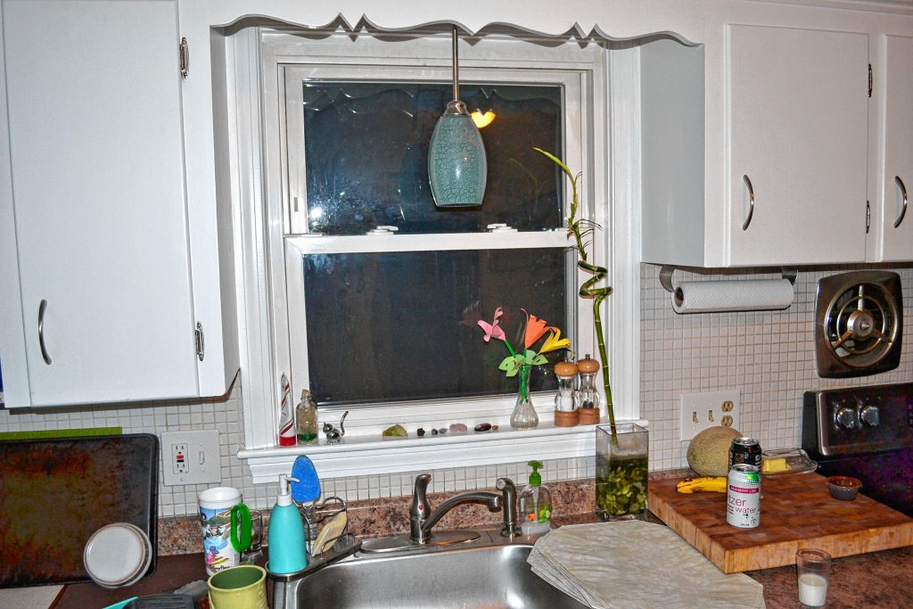 Updating a light fixture in your kitchen can make a big difference. TIM GOODWIN / Insider staff