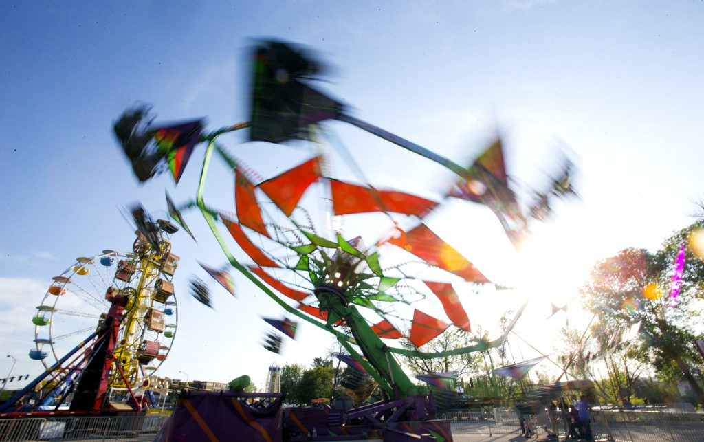 The Wind Ryder swirls in the afternoon son during the opening of the Kiwanis Spring Fair at the Everett Arena parking lot on Thursday, May 18, 2017. GEOFF FORESTER