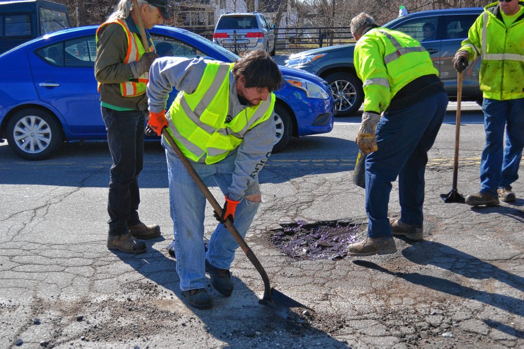 Tim filled some potholes with the Concord General Services crew last week at one of the busier spots in town – the intersection of Pleasant, Warren and North and South Fruit streets. Because it is spring in New Hampshire, and those potholes aren't going to fix themselves. KEVIN DEMERS / For the Insider