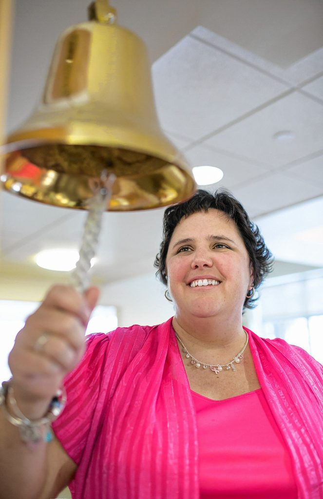 Lisa Ober rings the bell at the Payson Center for Cancer Care. Every time a cancer survivor finishes treatment at the Payson Center, they ring a bell.  At the start of Rock 'N Race, the bell will be rung in honor of all friends and family who have experienced cancer.  Courtesy