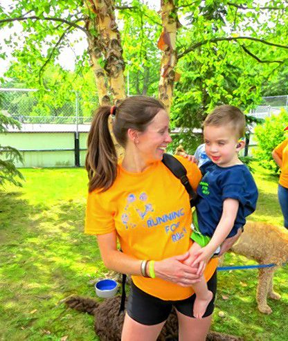 Karly Duquette hold her son, Riley, at last year's inaugural Running for Riley event at White Park. Courtesy of Shawn Moseley