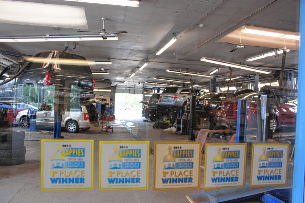At Carlson's Motor Sales, winner of two Cappies awards -- Best Used Car Dealer and Best Car Repair -- their eight service bays are always full of skilled technicians getting vehicles back in top shape. They also have an impressive lineup of Cappies award stickers on the window -- this one will be six in a row now. JON BODELL / Insider staff