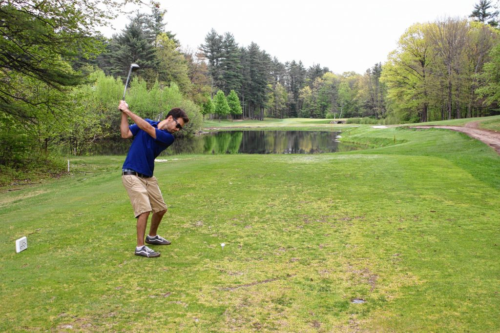 Jon tees off on the 14th hole at Beaver Meadow Golf Course, one of the more visually striking holes on the course. NICK STOICO / Monitor staff