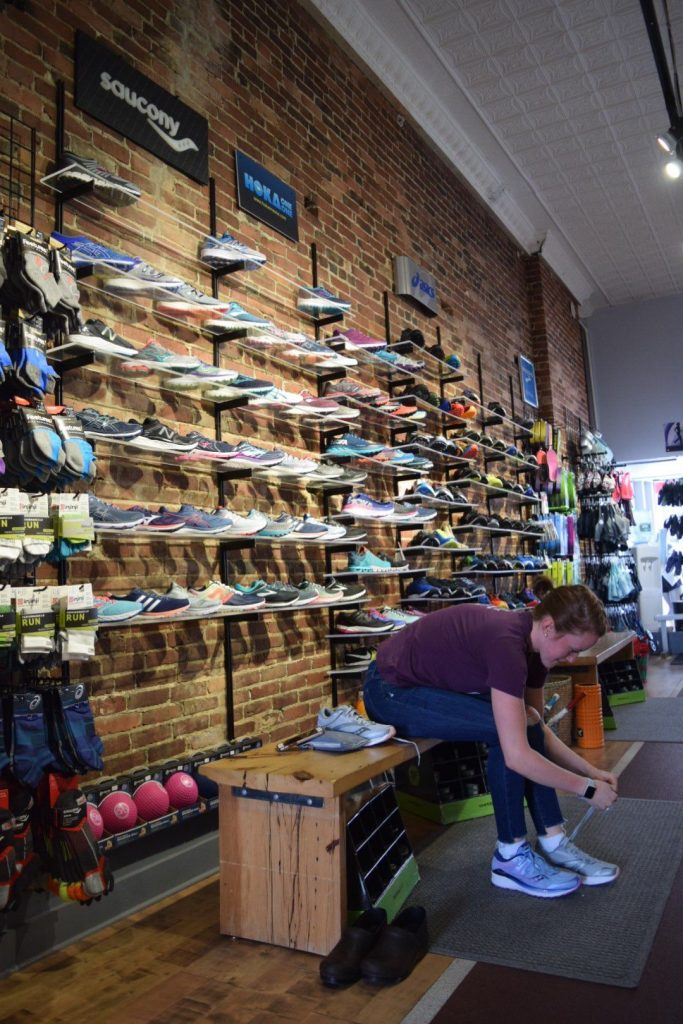 Libby Brooks, 22, of Sutton tries on a pair of shoes at Runner's Alley last week. It's one of a few places in town where you can get some great advice for new running shoes.