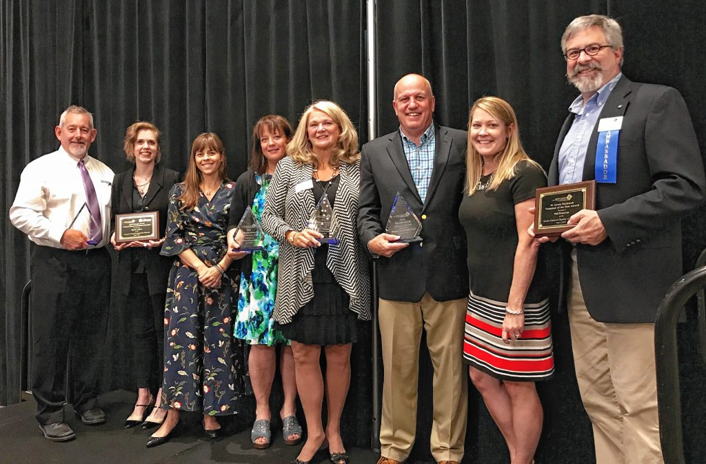 From left: Jonathan Halle of Warrenstreet Architects, Small Business of the Year; Elyssa Alfieri of Lilise Designer Resale, Concord Young Professional of the Year; Kate Fleming and Michelle Motuzas of Intown Concord, Nonprofit Business of the Year; Cindy Flanagan of Concord Dance Academy, Business Leader of the Year; Steve Duprey and Pam Bissonette of Duprey Hospitality LLC, Business of the Year; and Phil Donovan, W. Grant McIntosh Volunteer of the Year.  Courtesy of Kristina Carlson / Greater Concord Chamber of Commerce
