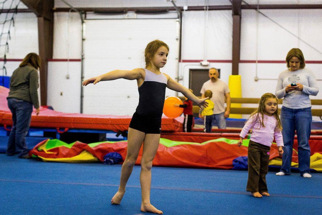 Abby Bradley, 9, of Bow, practices for an upcoming gymnastics meet during open gym time at Flipz Gymnastics in Concord on Saturday morning, Jan. 3, 2015.  (ELIZABETH FRANTZ / Monitor staff) ELIZABETH FRANTZ
