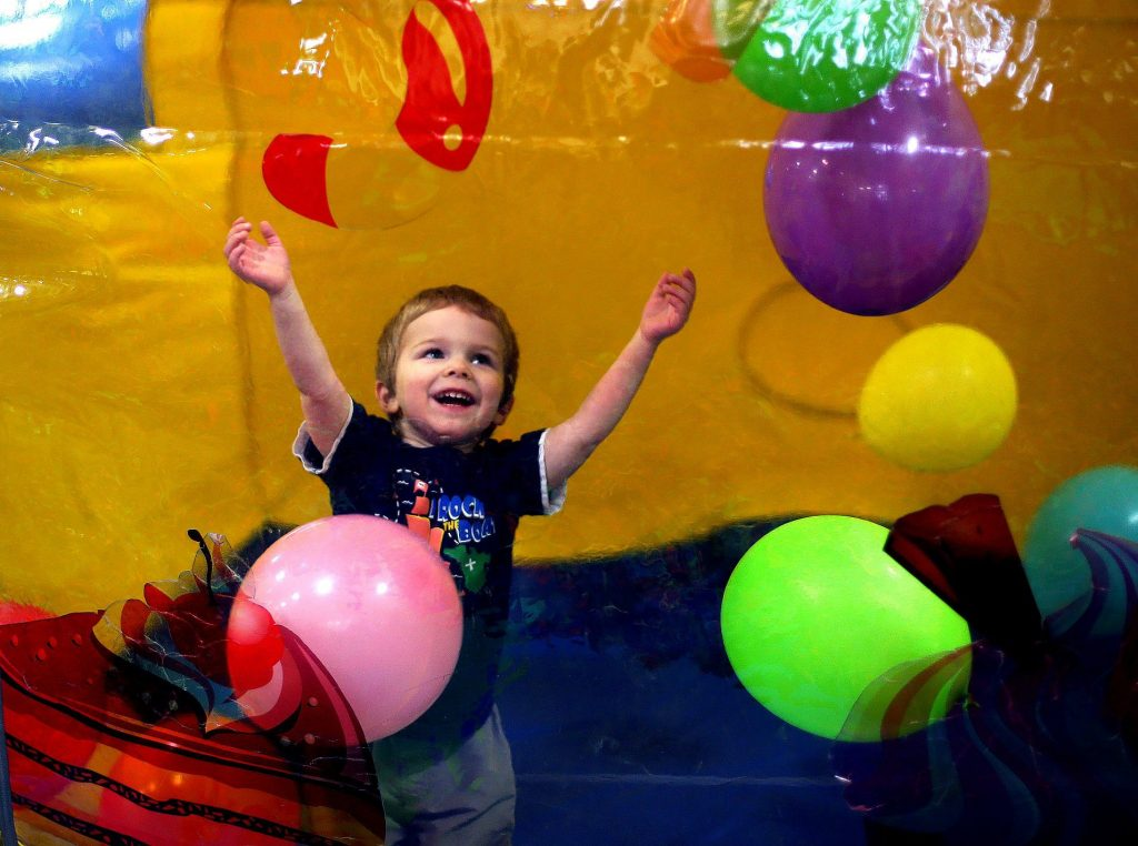 Zeke Harmon, 3, plays with balloons inside a bouncy house at the Krazy Kids indoor play center in Concord  with his family Monday. (GEOFF FORESTER / Monitor staff)