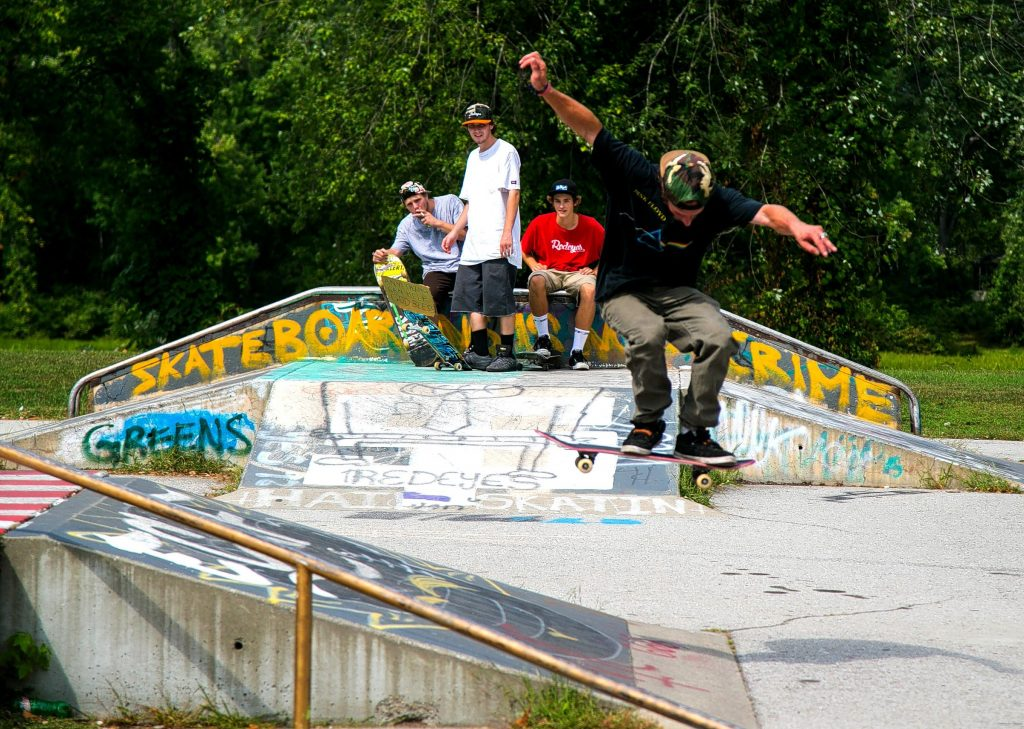 Tyler Castrogiovanni (left), Chris Rydel (middle) and Freddie Seekamp all watch as Nick Gambino attempts difficult jump at the Concord skateboarding park on Loudon Road earlier this week. Gambino was back from Colorado visiting friends.  (GEOFF FORESTER / Monitor staff) GEOFF FORESTER