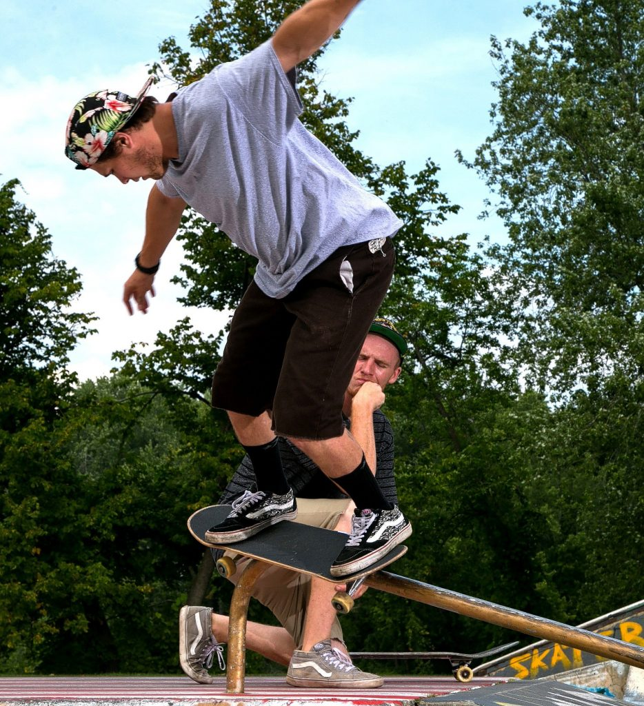 Scott Lamson of Concord watches as Tyler Castrogiovanni works the rail at the skateboarding park on Loudon Road this past week. A goup of friends spent the afternoon working their moves at the park behind Everitt Arena.  (GEOFF FORESTER / Monitor staff) GEOFF FORESTER