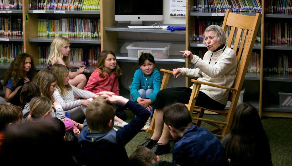 Clara Brogan, 92, spins a story to the second graders at Christa McAullife School in Concord Wednesday. Brogan comes in every other Thursday to do her storytelling at the school.  (GEOFF FORESTER / Monitor staff) GEOFF FORESTER