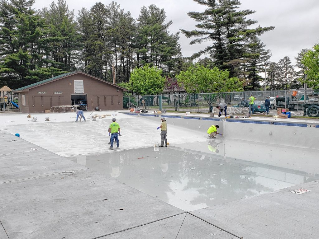 Workers put some finishing touches on the new pool at Keach Park, which will have a ribbon-cutting ceremony Wednesday. Courtesy of Concord General Services