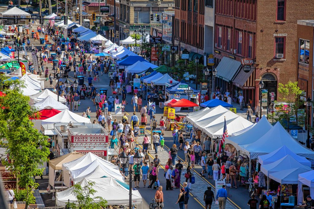 People walk along N. Main Street during opening day of Intown Concord's Market Days Festival, Thursday, June 23, 2016. (ELIZABETH FRANTZ / Monitor staff)