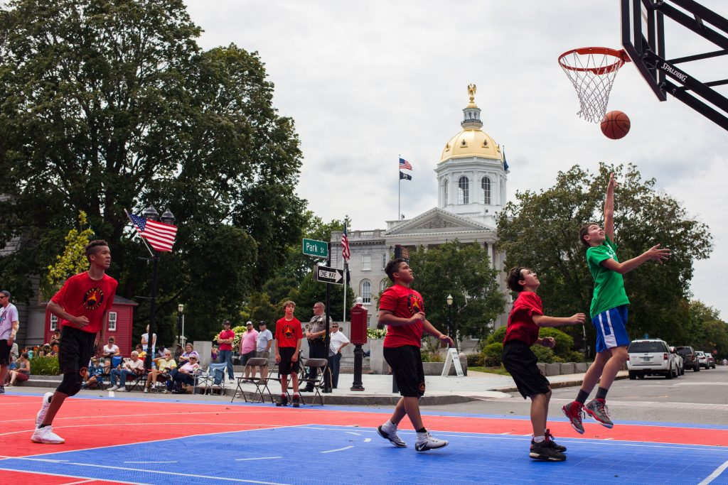 Nashua Sports Academy C4 team member Trevor Labrecque (right), 12, shoots a layup during a 3-on-3 boys basketball tournament game against the Cap City Basketball Spurs team during Rock On Fest in downtown Concord on Friday, Aug. 11, 2017. (ELIZABETH FRANTZ / Monitor staff) ELIZABETH FRANTZ