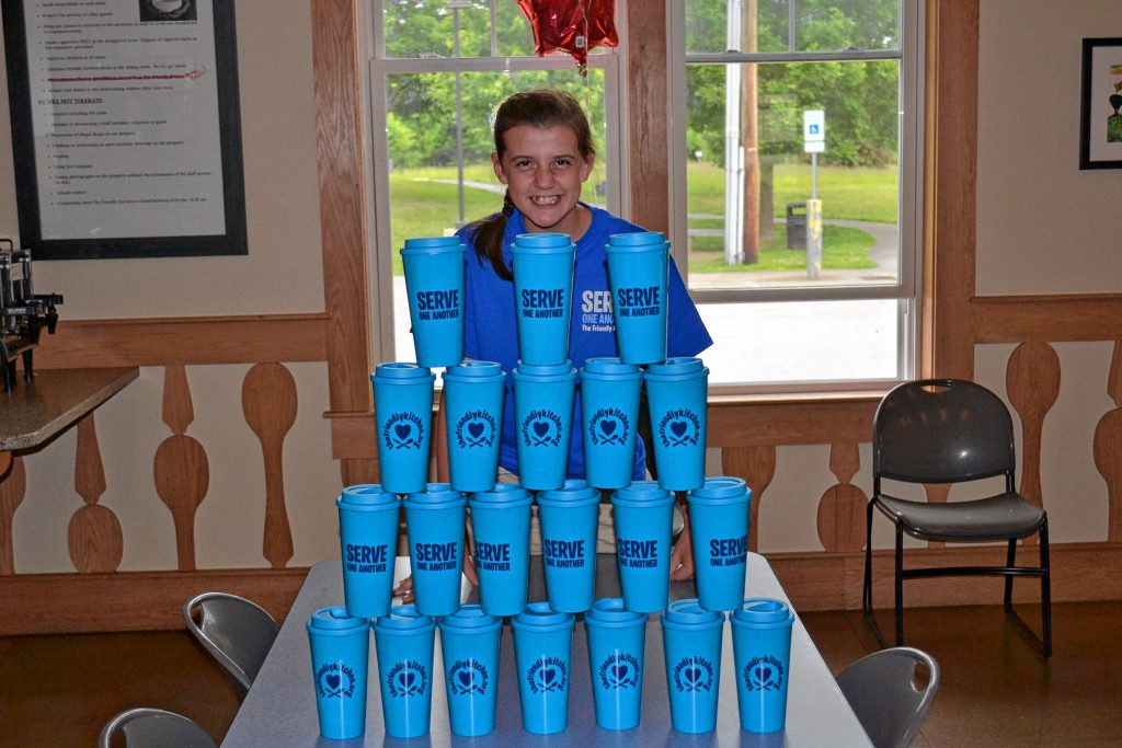 Sofia Payne, a 6th grader at St. John Regional School, is selling travel coffee cups to raise money for the Friendly Kitchen. TIM GOODWIN / Insider staff