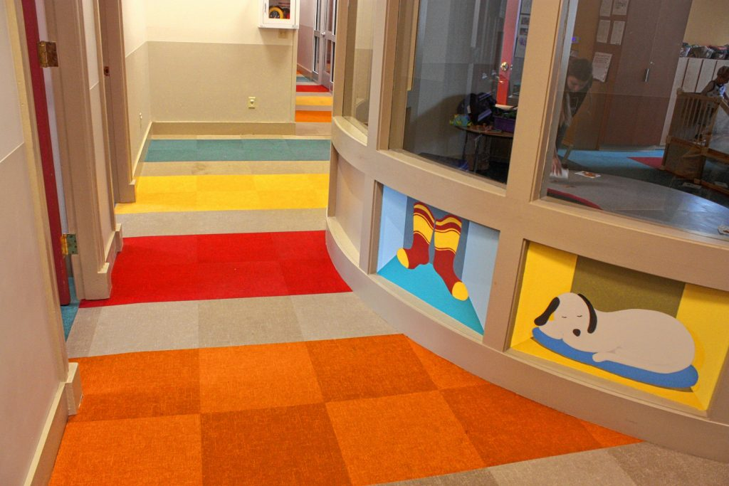 The Concord Family YMCA's Child Development Center has a fresh new look, complete with bright colors all over the carpets and walls, and some hand-painted artwork by local artist Leslie Ossoff. The bathrooms even have kid-sized sinks. JON BODELL / Insider staff
