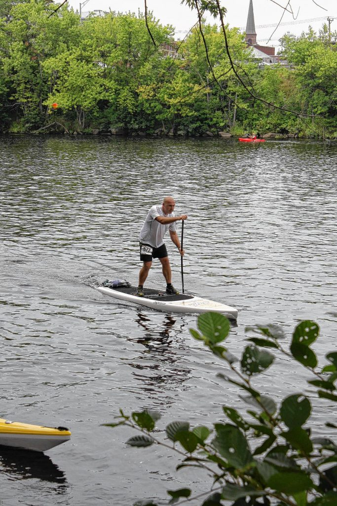 If you enter the New England Run Paddle Biathlon Championship that could be you stand-up paddle boarding around the Merrimack River.