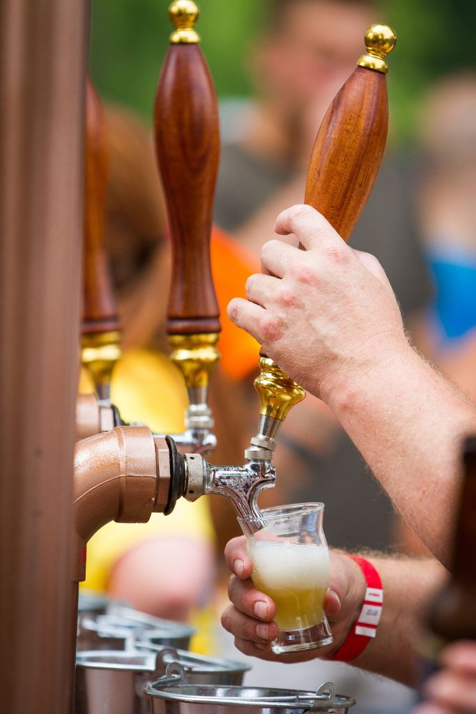 A sample of craft beer is served during the New Hampshire Brewers Festival at Kiwanis Riverfront Park in Concord on Saturday, July 22, 2017. (ELIZABETH FRANTZ / Monitor staff) ELIZABETH FRANTZ