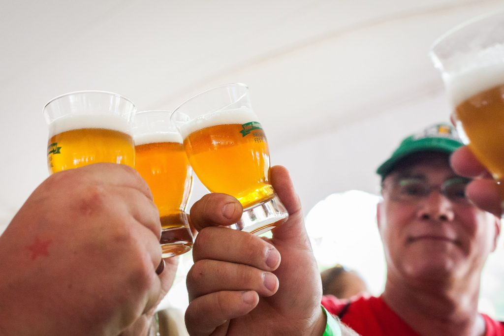 A group makes a toast before drinking a sample of craft beer at the New Hampshire Brewers Festival at Kiwanis Riverfront Park in Concord on Saturday, July 22, 2017. (ELIZABETH FRANTZ / Monitor staff) ELIZABETH FRANTZ