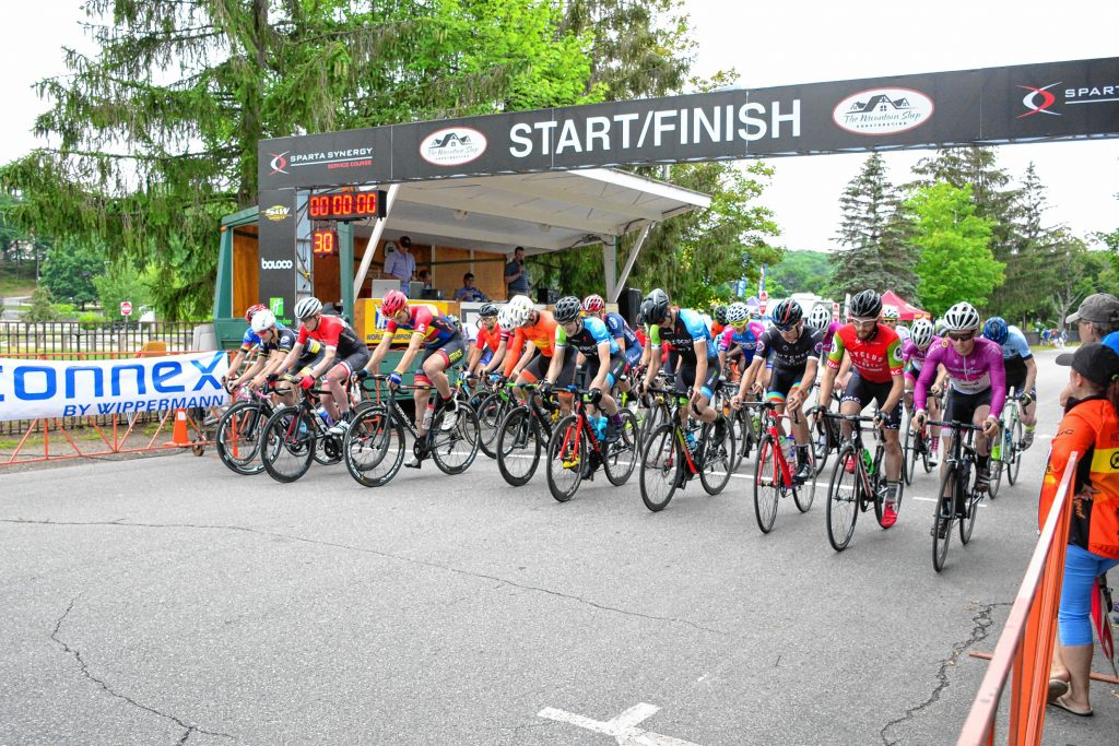 Cyclists pedal off the starting line at the 2017 Concord Criterium outside White Park in Concord last August.  Courtesy of Patrick Ruane