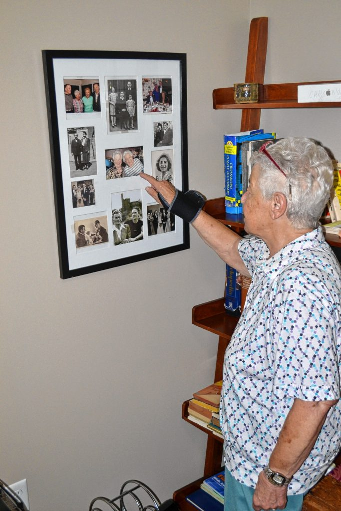 Ellen Oppenheimer looks at family pictures at her Concord home last week. Oppenheimer will talk about her book, Flight to Freedom, at Gibson's Bookstore on Aug. 8. TIM GOODWIN / Insider staff