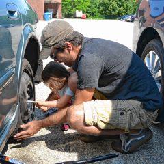Jon's daughter helped him change a flat tire last week